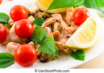 Salad of blanched pieces of seafood on a white plate...