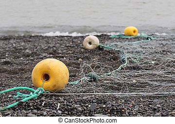 Floats for fishing nets on the black Chukotka coast during...