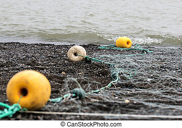 Net with floats on the black Chukotka coast during the...