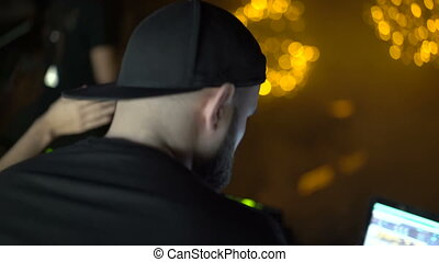 Back look of bearded DJ in night club 4K.