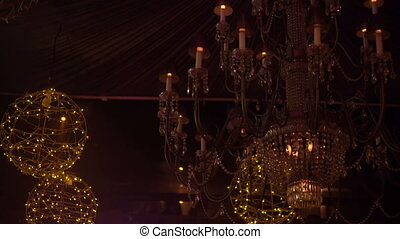 Crystal chandelier with golden garlands and soundlights