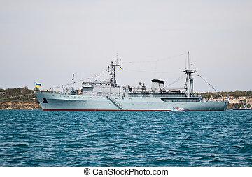 warship 4 - A grey navy warship anchored at sea
