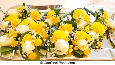 yellow bouquets on white table.