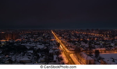 Wide view dusk to night town road at speed motion