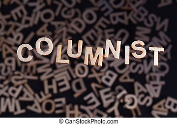 Columnist text in wooden letters - Columnist wooden letters...