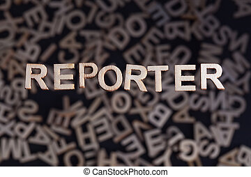 Reporter text in wooden letters - Reporter wooden letters...