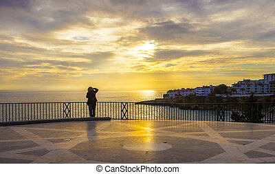 Photographer staying at Balcon de Europa - Mature female...