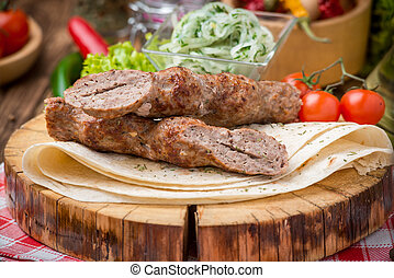 grilled beef meat kebabs - grilled beef meat on the grill...