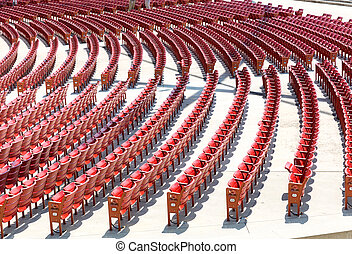 Empty open air theater seats. - Empty open air theater red...