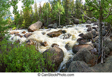 Panoramic view of stormy mountain river at Estes Park,...