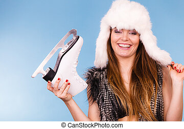 Fur cap and smiling lady. - Winter, clothing, sport concept....