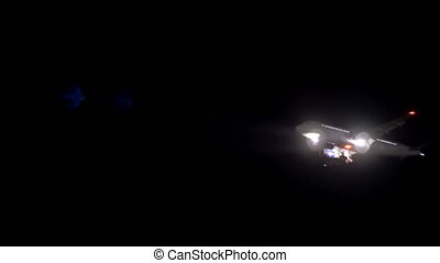 Passenger Airliner in the night sky.