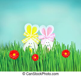 Colored easter eggs bunny on green grass - Colored easter...