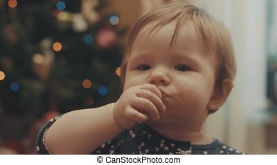 Funny little baby eating biscuit. Close up 4K.