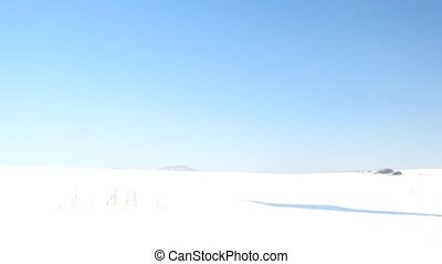 Winter tourist with snowshoes walk in snowy drift. Hiker in...