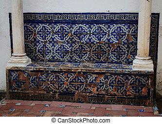 Glazed ceramic mosaic on bench Gardens of Alczar Palace,...