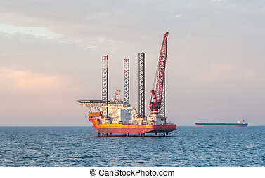Offshore jack-up barge and an oil tanker - Flat-bottomed...
