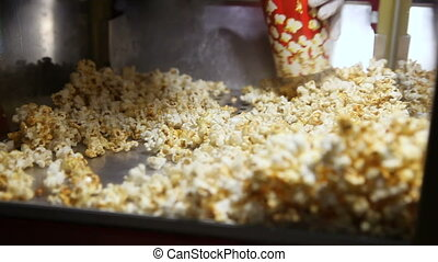 Shovel gaining microwave popcorn - Woman picking up a shovel...