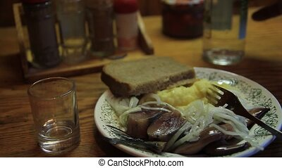 vodka and herring - dinner snack with vodka and herring,...