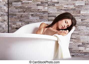 Bathing woman relaxing in bath smiling relaxing