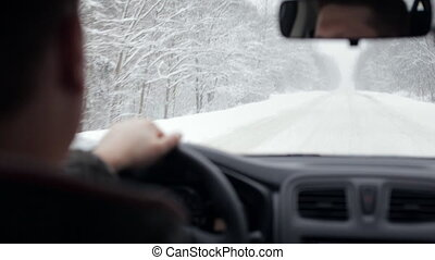 Snowy winter road driving - Snowy winter road - view from...