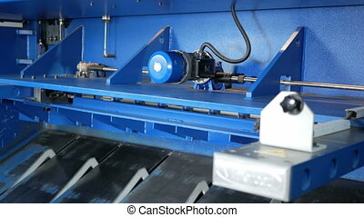 Machine for cutting sheet metal. Large hydraulic guillotine...