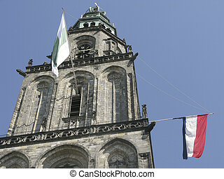Martinitower in Groningen, The Netherlands with flags -...