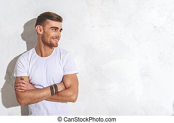 Confident guy expressing positive emotions