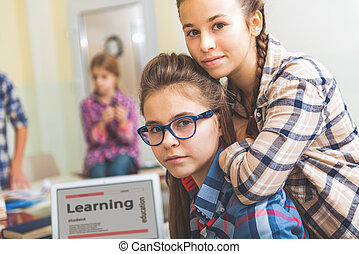 Smart female pupils in studying atmosphere - Curious girls...