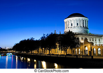 Four Courts - River Liffey and Four Courts building in...