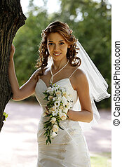 Beautiful bride - The beautiful bride with bouquet in park
