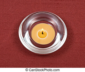 Beeswax candle in crystal bowl - Burning yellow beeswax...