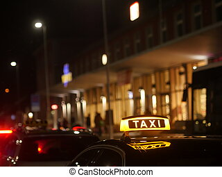 taxi sign German - Taxi sign on the roof of a taxi at night
