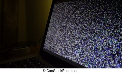 Static noise of flickering detuned TV or monitor laptop...