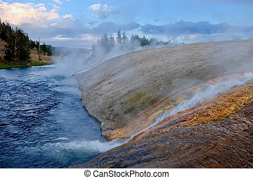 Steaming River of Yellowstone at sunset. - Hot water from...
