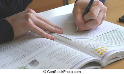 Student writes the text on the sheet on the lesson - Student...