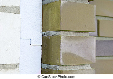 Thermal insulation of a house wall