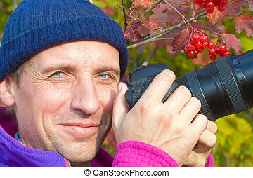 Happy photographer on arrowwood bush background - Happy...