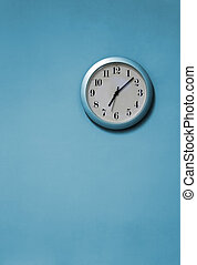 Blue clock - A blue and white clock on a blue wall
