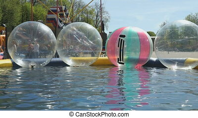 Large inflatable balls floating in swimming pool - Large...