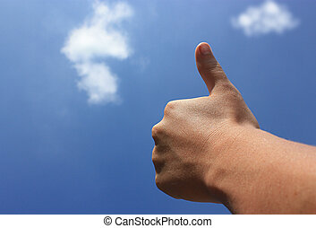 a job well done - a thumb reaches to the sky signaling a...
