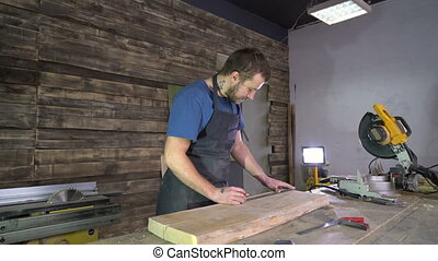 modern carpenter at work in his workshop