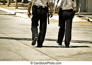 two policemen on patrol in a local festival