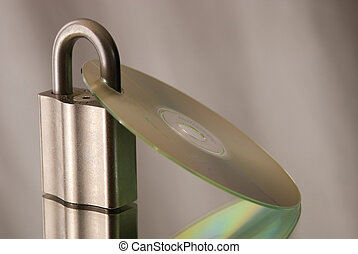 Data security - A photo of a compact disc and a lock,...