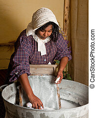 Washing laundry the old way - Victorian woman washing...
