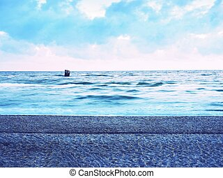 Beautiful marine view on sea coast line with smooth  water over  sandy beach