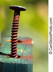 Rustic screw - Close up shot of rustic screw on the wooden...