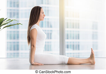 Young attractive woman in Dandasana pose against floor...