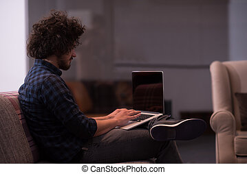 man working with laptop - technology, home and lifestyle...