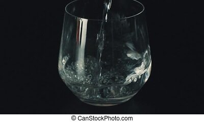 Pouring drink into a glass